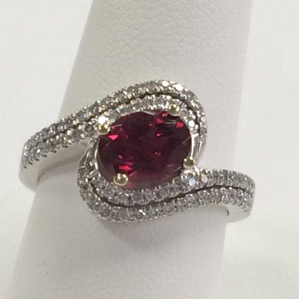 This is a stunning 14kt white gold diamond ring featuring a pink tourmaline.
