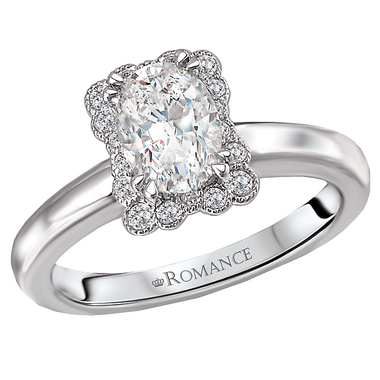 A stunning halo ring featuring round diamonds and a sleek, white gold band.