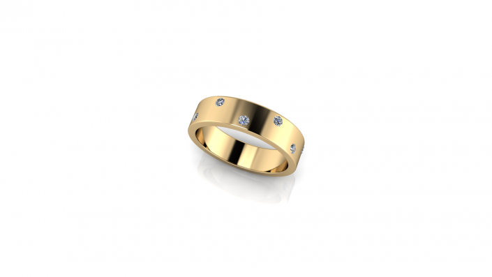 This custom gold wedding band is a beautiful example of what we are able to create for you at J Olivers.