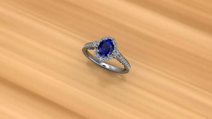 This classic looking sapphire ring is crafted with white gold and diamond embellishments to create a halo around the center stone.