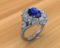 This is a stunning custom made ring.  As the center sapphire stone sparkles diamonds encompass it to highlight this beautiful stone.