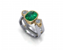 Not all engagement pieces have to be diamonds.  This beautiful piece displays a gorgeous emerald stone with twin diamonds alongside it.  This ring shows beautiful contrast throughout and is surely a unique design that will be cherished for years to come.
