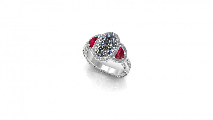 This elegant ring displays an oval cut diamond alongside two sparkling rubies.  A ring fit for a princess this custom engagement ring is the perfect display of love.