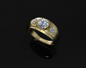 This is a custom designed gold ring that features three stunning diamonds.