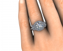 This beautiful ring sits perfectly on its bride's finger.  A tri-stone display with halos around each.