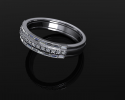 "This stunning white gold ring with three layers of diamond embellishments crafted to have a ""stacked"" ring look."