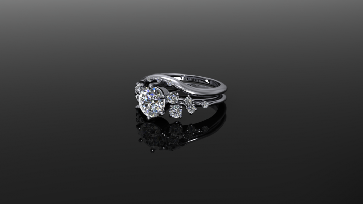 This is a beautiful sterling silver ring that displays an array of twinkling diamonds.  As the complementing stones build on one another they create a highlight for the beautiful center stone.
