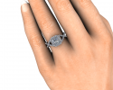 This is a display of how this custom ring will look on its beautiful bride to be's finger.