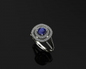 This beautiful sapphire ring creates the perfect engagement piece.  Encompassed in a sparkling double halo of diamonds sits a cushion-shaped sapphire.  Allow us to create you a unique piece such as this one at J Olivers.